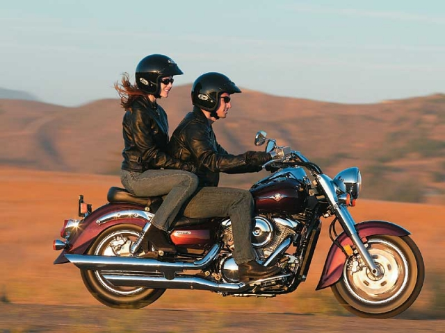 Девушка и парень на мотоцикле