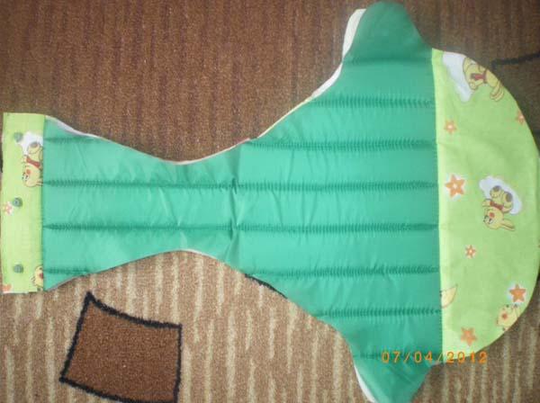 Изнанка сидения для ходунков, ткань зелёного цвета