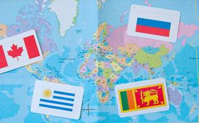 Карточки с флагами на карте мира