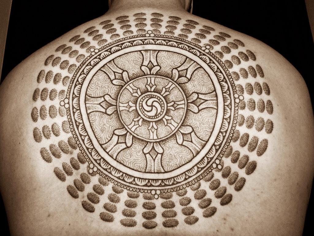 Татуировка Колесо Дхармы