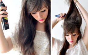 Женщина брызгает лаком и начесывает волосы
